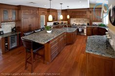 The consistent speckling of Green Ventura brings together the elements in this spacious kitchen.