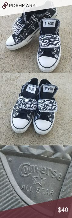Zebra converse Converse brand shoes. Women's size 8 men's size 6. Pre-owned. Good condition. Couple small flaws not noticable. Double tongue. Black and white. Zebra print detail. Converse Shoes Sneakers