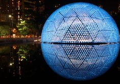 "'Rising Moon' is the name of the installation by Daydreamers Design in the 'Wonderland 2013 Lantern Festival"" at Victoria Park in Hong Kong – made from recycled water bottles"