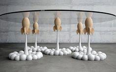 """Stelios Mousarris ha creato """"Rocket"""" il tavolino che sembra retto dai razzi della Pixar """"Rocket"""" è un tavolino da caffè molto particolare. E' divertente ma prodotto mixando tecniche costruttive diverse. Insomma, fa sorridere si, ma si vede che si prende anche sul serio. Opera del fantas #design #tavolo #scultura"""