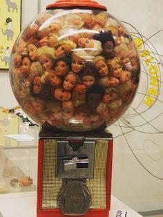 Barbie heads inside a gumball machine - Gumball Barbie