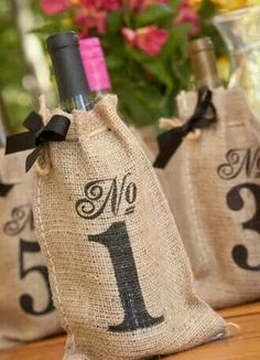 Centerpieces/table numbers for reception but then bride and groom keep wine bottles and open them on that number anniversary :)
