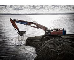 Michael Molloy. Digger dredging area for new port