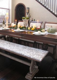 Fall tablescape - shot of her wine cellar under the stairs - love the sconce next to the iron door.