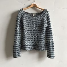 | Free People Wool Blend Sweater Beautiful cream, charcoal and light blue open knit sweater.  73% acrylic and 27% wool.  In gently used condition. Free People Sweaters