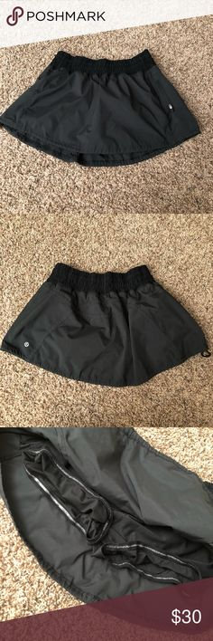 Lululemon black tracker skort Skirt has built-in shorts and is in good condition. A bit older in style but is not reflected in the quality. Lots of life left. lululemon athletica Skirts