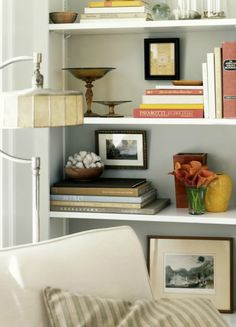 Cozy corner, simple attractive arrangement on bookshelves David Prince photo