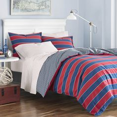 Add bold style to your bedroom with the Poppy & Fritz Parker Cotton Stripe Comforter Set. This set features an attractive nautical stripe pattern in red and blue with a gingham reverse pattern that you will love.