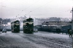 Edinburgh.  Last trams up the mound 1956    Gosh it looks so cold, doesn't it? And it was colder in those days. Edinburgh was a cold, grey city, and you had to watch out not to catch your foot in the tram lines as you crossed the road.