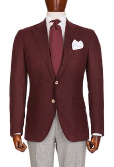 Burgundy jacket with light gray pants