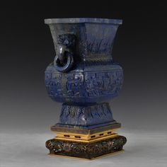 Extraordinary carved Chinese Lapis-lazuli square Gu vase on a gilt bronze enamel cloisonne stand.