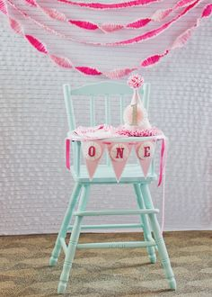 Highchair and smash cake set-up for first birthday! Love this pink ombre-themed #kidsparty