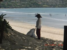 Cleaning Jimbaran beach.
