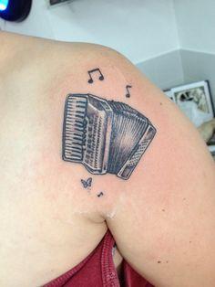 Acordeon, tatuaje