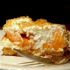 In this cool, creamy no-bake dessert layers of a whipped marshmallow cream and sweet, ripe peaches sit atop a buttery graham cracker crust.