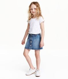 Check this out! Gently flared skirt in washed stretch cotton. Adjustable, elasticized waistband, snap fasteners at top, and decorative buttons at hem. - Visit hm.com to see more.
