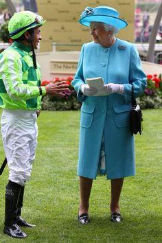 California Chrome's jockey Victor Espinoza with The Queen