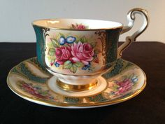 BEAUTIFUL PARAGON CHINA FLORAL/GREEN/GOLD CUP AND SAUCER