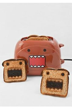 I already have a fancy toaster that works great, but if I didn't this Domo Toaster would move to the top of my list. IF I liked burnt toast. Looks a little dark in spots, no?