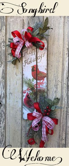 These beautiful cardinals are singing a sweet welcome to all who come to your door. Love these wreaths.  #handmade #holidaydecor  #wreaths #christmas #affiliatelink