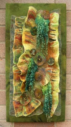 'Peeling Tree Bark 1'.  Various wools slashed and manipulated to give a relief effect.