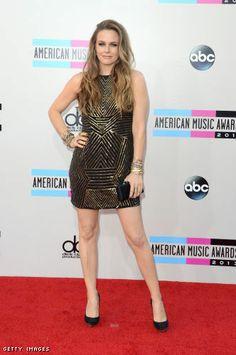 Alicia Silverstone in a Nicole Miller mini dress an Stella McCartney pumps