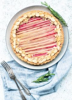 Apricot Rhubarb Almond Tart. Almond cookie-like crust, sliced and layered apricots on the bottom, topped with a insanely delicious almond cream, covered in rhubarb ribbons and a crumble topping!