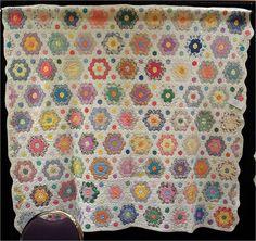 Quilt Inspiration: Grandmother's Flower Garden. Vintage Color-pop Garden quilt exhibited by Vicki Calahan, 2013 AZQG