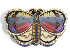 A gold an enamel snuffbox for the Chinese market, Remond, Lamy & Co, Geneva, 1801-1804. In the form of a butterfly, the lid colourfully enamelled, the sides and base enamelled in blue within taille d'epargne borders, the dividing panels decorated with water fowl and reeds.