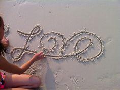 Cute Love Writing in Sands
