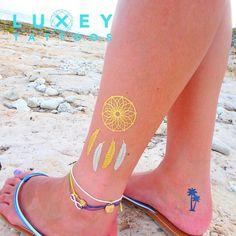 海でキラキラ、かわいい♪  http://luxeytattoos.jp/i/ #リュクシータトゥー #タトゥーシール #ハワイ #アロハ #花 #かわいい #アクセサリー #ビーチ #パーティー #ヒッピー #70s #おしゃれ #アクセント #ファッション #トレンド #luxeytattoos #tattoosticker #girl #cute #accessories #partydress #hippie #gold #fashion #2016ss #happy #tattoogirl #flowers #beach