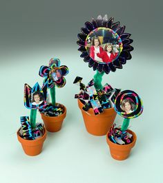 """A garden of your friends, pets, or family will look great """"growing"""" on your windowsill and it never needs watering! What a cool photo display--no green thumb required!"""