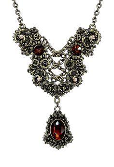 Collier pendentif corset mécanique argentée et pierres rouges Steampunk