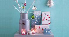 Une guirlande d'étoiles pour décorer mes cadeaux de NoëlDécorez vos cadeaux de Noël d'une pluie d'étoiles en les entourant d'une guirlande argentée et étoilée.