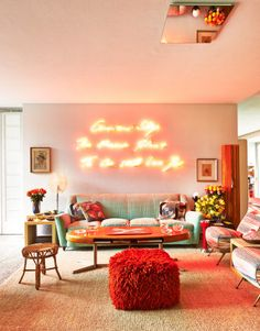 The family room, with Tracey Emin's Neon Life: A Portrait of Bruno Ragazzi, 2010, a 1950s vintage sofa, and vintage chairs covered in Missoni Home silk jacquard. -Wmag