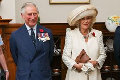 Prince Charles, Prince of Wales, and Camilla, Duchess of Cornwall, look on during prior to the Prince of Wales receiving his new Military Warrants at Government House on November 4, 2015 in Wellington, New Zealand. The Royal couple are on a 12-day tour visiting seven regions in New Zealand and three states and one territory in Australia.