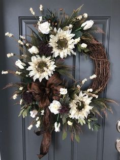 fall wreaths This elegant fall wreath is designed with cream sunflowers, roses and rosebuds surrounded with dark green ferns tipped in tan and brown. Elegant Fall Wreaths, Easy Fall Wreaths, Diy Fall Wreath, Thanksgiving Wreaths, Holiday Wreaths, Sunflowers And Roses, Fall Door Decorations, Sunflower Wreaths, Arte Floral