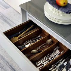 Poggenpohl walnut cutlery insert with crosswise divider, minimalism needs lots of storage  #poggenpohl #kitchen #organization #accessories #POGGstory