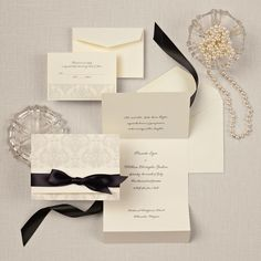 Elegant Damask Wedding Invitation in Ecru | #exclusivelyweddings | #weddinginvitations