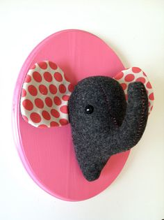 This is a stuffed felt elephant head that has been mounted on a painted and sealed wood plaque. You choose the colors! It is hand sewn and is an