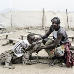 The Hyena Handlers of Nigeria. Photography from Pieter Hugo.