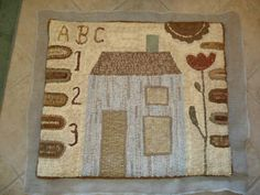 "Nice hooked rug ~ could be ""Q & E"" if you make it small, mat size not rug size."