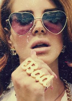 Lana Del Rey's gold frame, heart-shaped sunglasses.
