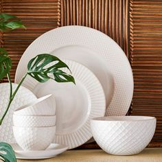 I love the idea of simple, textured, interesting large/overscaled white plates/platters hung in the center of the three framed moldings behind your table.  Textured Dinnerware Set - Mix + Match | west elm