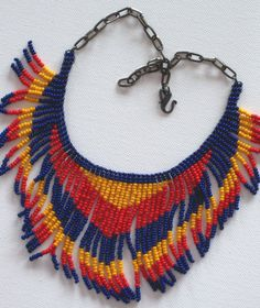 Native American style tribal fringed collar necklace in red, yellow and cobalt blue on Etsy, $55.00