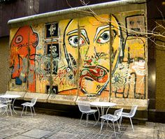 a largely intact section of the Berlin Wall in NYC @ 520 Madison Ave, 53rd St This Berlin Wall segment is painted by Thierry Noir.