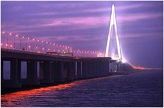 At 22 miles, The Hangzhou Bay Bridge is the longest ocean-crossing bridge in the world.It reduces travel times from the Yangtse River Delta area around Shanghai to the port city of Ningbo from 4 hours to a mere 2.5 hours.