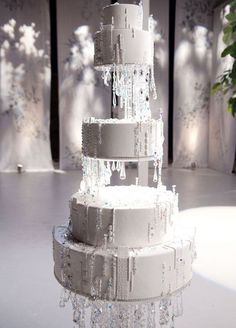 Edible icicles drip down the sides of this enchanting five-tiered wintry white confection. 10 Festive & Frosty Winter Wedding Cakes
