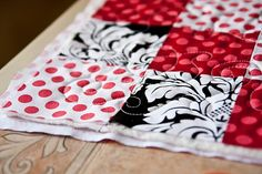 Free motion quilt tutorial- black, white, and red quilt for baby.