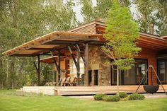 Contemporary prefab home, Montana: Modern prefab modular homes - garage door window feature